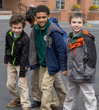 Four students walk together outside